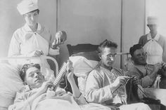Photographic Print: Wounded Soldiers Knitting under the Watchful Eye of Nurses by Stocktrek Images : 24x16in