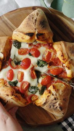 This dinnertime star attraction is five sides of cream cheese and bacon stuffed dough filled in the middle with mozzarella, tomatoes and basil.