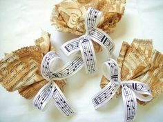 Music themed wedding favors with sheet music ribbon.  Keywords: #musicthemedweddings #jevelweddingplanning Follow Us: www.jevelweddingplanning.com  www.facebook.com/jevelweddingplanning/