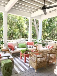 Southern Living Idea House porch - The living room/dining room combo opened out onto this porch. Notice how Harper repeated the same color scheme (neutral with accents of green and coral) to make it feel like one continuous space.