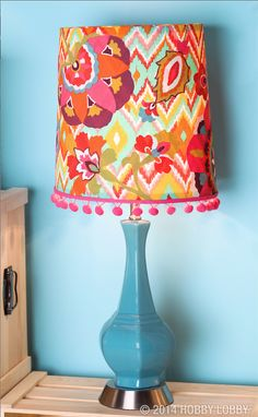 We chose a cool bohemian print for this eye-popping table lamp. But before we applied to the shade, we added a handful of quirky floral appliqués. Here's how: cut leaves and flowers from coordinating fabric, back them with fusible web, and iron them on according to the manufacturer's instructions.