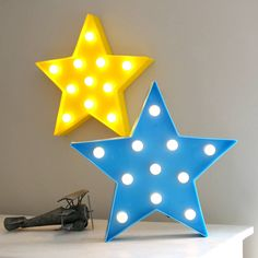 Fun and fabulous decorative lighting.Brighten up any home with these cool LED fun lights versatile and easy to display by hanging on a wall or free standing. Ideal for both kids and adults in three colours - yellow, blue and white. Powered by two AA batteries (not supplied) and have a neat on / off switch on their side. Neatly boxed perfect as an unusual home gift. Indoor use only.Plastic, LED bulbsH32 x W34 x D5cm
