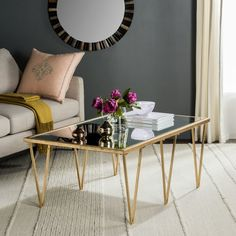 Featuring a bold, geometric, gold leaf-finished frame and clear glass top, this simple yet stylish this coffee table brings a glam touch to your living room or parlor ensemble.