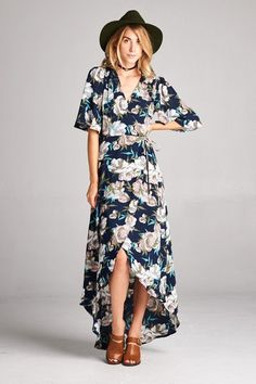 Wrap dress with loose fit sleeves and v-neckline. It has slightly longer sleeves for the fall season and the fabric choices and color have more of a fall season feel. This high low dress is an easy wr
