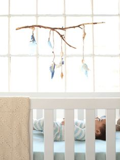 All you need for this stick mobile: a dry branch, sandpaper, thin rope, felt, seashells, and tacky glue. It will send little dreamers off to sleep!