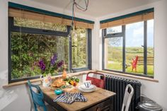 The light-filled dining area looks out over rolling countryside