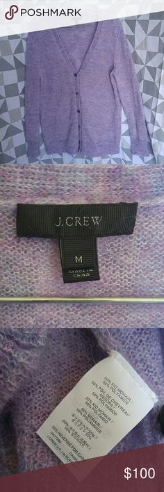J. Crew purple souffle mohair cardigan sweater Size medium J. Crew button up 'souffle' cardigan. Pretty light purple/lilac with small bits of pink throughout. Really soft and unique, fuzzy lightweight sweater. Kid mohair/polyamide blend. Sizing runs a bit large. J. Crew Sweaters