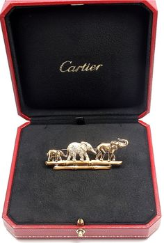 """Diamonds in the Library - """"Elephant Family"""" brooch, Cartier. Gold, diamonds, and emeralds."""