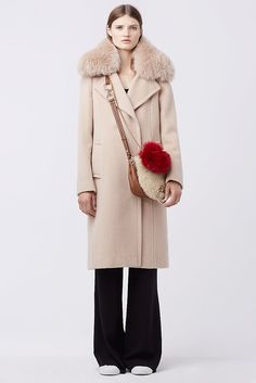 The Sutton coat adds instant drama. With a chic fur collar and front slit pockets.