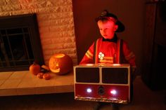 Fire Engine Halloween Costume... I might have to give this a whirl, my poor kid is begging to be a firetruck, not a fireman for halloween... yes folks, a firetruck, he even specified he wants a ladder and hose... Humph