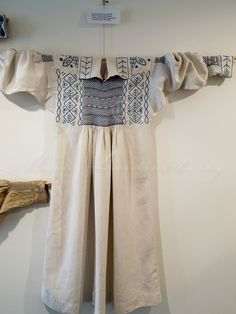 Tilehurst smock West Sussex. White with blue embroidery and smocking