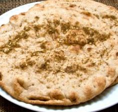 Recipe for Zatar (Middle Eastern spice blend) and Stuffed Mediterranean Breakfast Pizza (pita with Greek yogurt, feta, and zatar).