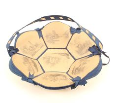 A rare card and blue ribbon sewing basket, circa 1850, formed from seven pencil drawn landscape p