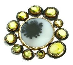 Judy Geib Plus Alpha -  Dream pond brooch. Patterned indian blob agate surrounded by peridots, set in silver and 18k.