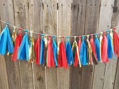 Check out this item in my Etsy shop https://www.etsy.com/listing/487363169/wonder-woman-theme-tassel-garland-super