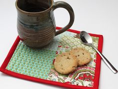 I thought I'd bring another one of the tutorials I did for Delish magazine home again today. This mug rug would be the perfect gift to make for someone this Christmas, especially nice because you could even use up some scraps! Plus, you could certainly get a few done in under an hour…yay for gifts …