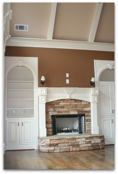 amicalola cottage images | Custom Built in Cabinets, Mantel detail, beamed ceiling and stack rock ...