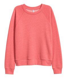 Terracotta. Lightweight sweatshirt with long raglan sleeves and ribbing at neckline, cuffs, and hem.