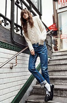 Pair a chunky cable knit sweater with boyfriend jeans for an effortlessly chic daytime look. Grace Hartzel photographed by Lachlan Bailey for Vogue Paris.