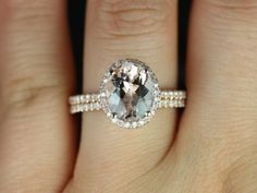 Federella Original Size 14kt Rose Gold Thin Oval Morganite Halo Wedding Set (Other metals and stone options available). $1,405.00, via Etsy.