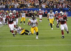 James Harrison (92) making Super Bowl history with his unforgettable 100 yd. intereception return for a touchdown in Super Bowl XLIII against the Arizona Cardinals. (2009)