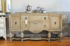 French Provincial Sideboard Buffet painted a warm grey with Annie Sloan Chalk Paint in a custom mix of French Linen / Old White with Old Violet and Old White in the details. @Michele Morales Rivard  $745