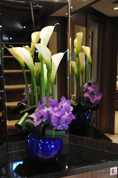 Arums and vanda orchids reception vase display