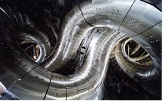 Largest superconducting stellarator in the world.  This Japanese fusion research device consists of intertwined coils of superconducting material, and is designed to contain a 100-million-degree nuclear fusion plasma. The research aims to solve the many engineering challenges that must be overcome in order for fusion reactors to produce more energy than they consume.