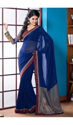 Get the diva look just like #Alia #Bhatt by draping this Navy Blue #2 #States #inspired #saree. Made from #Chiffon, the saree is an elegant piece of attire perfect for parties and events where you want to give yourself a complete ethnic and traditional look. The saree is embellished gracefully with fancy heavy lace patta work that adds more glam. The saree comes with matching Coffee Art Silk blouse piece that can be custom tailored for upto bust size of 42 inches.