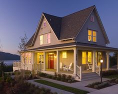 wraparound porch...yard design...pop of color from the door....big lake in your backyard (!)