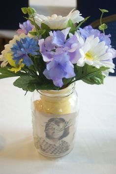 Centerpieces from my grandparents 50th wedding anniversary. Mason jars with pics from their lives together.