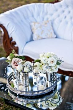 Mirrored tray adorned with flower-filled vintage mint julep cups
