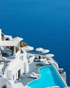 Katikies Hotel  ( Santorini, Greece )  Kirini restaurant and the main pool perch on the cliffside, 300m above the water. #Jetsetter #JSVolcano #JSBeachDining