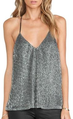 This cami features v neck , racerback and metallic silver fabric . Wear this pretty party top with shorts and heels.