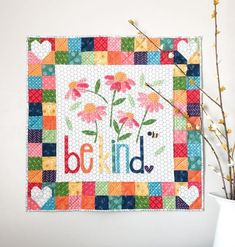 This delightfully colorful and scrappy mini quilt reminds all of us to simply, Be Kind. Raw edge applique and patchwork borders create a beautiful centerpiece for any wall. Mini Quilts, Baby Quilts, Small Quilts, Mini Quilt Patterns, Quilting Patterns, Quilting Ideas, Quilt Patterns For Beginners, Heart Quilt Pattern, Quilting Frames