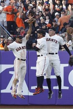 San Francisco Giants' Andreas Torres, left, Gregor Blanco, center, and Hunter Pence celebrate after they defeated the Los Angeles Dodgers 4-2 in a baseball game in San Francisco, Saturday, July 6, 2013