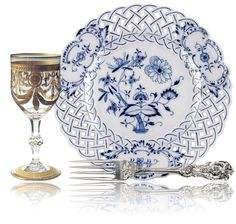 "Regal tableware set with ""Congress"" glass pattern with gold swags from St. Louis, ""Francis I"" silver pattern from Reed & Barton, and ""Blue Onion"" china pattern with blue & white pierced rim from Meissen."