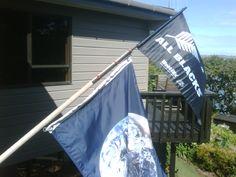 All Blacks flag tops the earth flag.