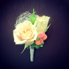 Spray rose boutonniere with decorative wire + hypericum berries