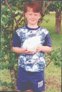 This is 6-year-old Alex W. holding his very own chicken mummy. His mother Paula has graciously shared her chicken mummy recipe with readers at the Mummy Tombs. The purpose of this activity is to expose students to a basic science/history activity to experience the art (takes 6 weeks)