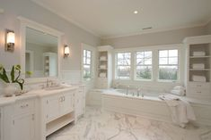 Milton Development: Amazing master bathroom with gray paint color paired with white wall paneling. White ...
