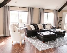 An upholstered chair, and a light rug & drapes balance the brown (although, I think a larger rug would look nice)