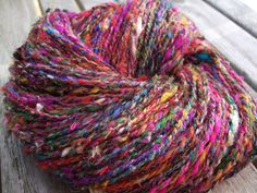 """https://flic.kr/p/8ygfzv   From India with love   Chunky superhappy """"From India with love"""". Handspun from 100% recycled sari silk.  63g/176m , 2,3o/193y"""
