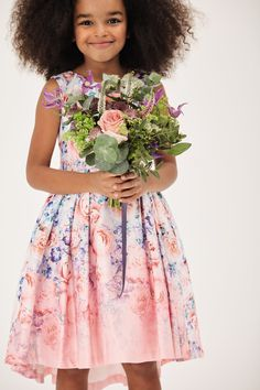 This pretty floral dress with beautiful pleating is a perfect outfit for your flower girl.