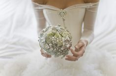 Love this broach bouquet.and check out the wedding gown on the bride holding… Wedding Blog, Dream Wedding, Wedding Day, Wedding Stuff, Bling Wedding, Wedding Vintage, Wedding Things, Wedding Bouquets, Wedding Gowns