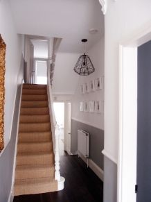 white banister, beige carpet and grey wall under dado rail hallway at home Grey And White Hallway, Dark Hallway, Dado Rail Hallway, Tiled Hallway, White Banister, Hallway Designs, Hallway Ideas, Staircase Ideas, Hallway Colours