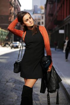 Andy Torres wearing knee high boots and H&M Studio collection in New York…