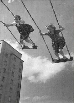 Here are two little swingers-Who aren't afraid of a thing-All they know for that moment-Is how exhilarating it is to swing-Reaching higher and higher-That's where they want to be-Who knows what's in their future-For now their young and their free.