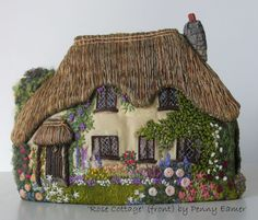 This tea cozy looks so real! I think I'll walk up to the door and go inside! So beautiful.