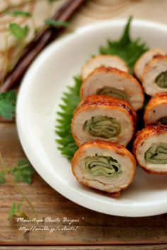 Thin chicken slices, cheese slice, shiso leaf wrapped up, rolled in potato starch and cooked in a skillet with soy sauce, mirin and sugar.